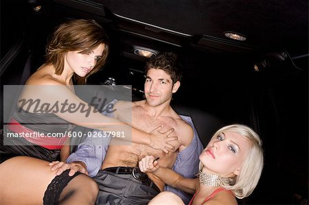 Women Undressing Man in Back of Limousine Stock Photo - Premium Royalty-Free, Image code: 600-02637981