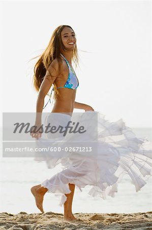 Woman Dancing on Beach Stock Photo - Premium Royalty-Free, Image code: 600-02671213