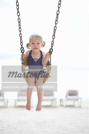 Girl Wearing Bathing Suit in Swing on Beach, Cancun, Mexico Stock Photo - Premium Royalty-Free, Image code: 600-02686150
