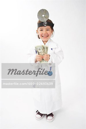 Girl Dressed as Doctor Stock Photo - Premium Royalty-Free, Image code: 600-02693639