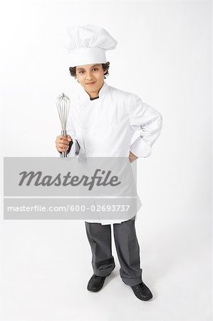 Boy Dressed Up as a Chef Holding a Whisk Stock Photo - Premium Royalty-Free, Image code: 600-02693737