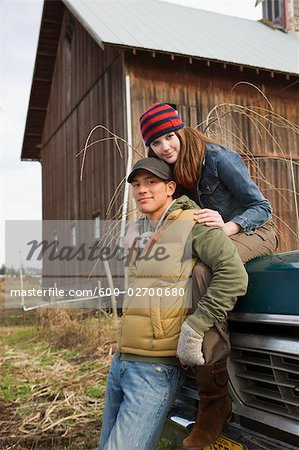 Portrait of Young Couple on a Farm in Hillsboro, Oregon, USA Stock Photo - Premium Royalty-Free, Image code: 600-02700680