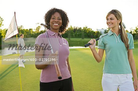 Friends Playing Golf, Burlington, Ontario, Canada Stock Photo - Premium Royalty-Free, Image code: 600-02701195