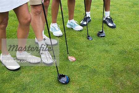 Close-up of Golfers' Feet Stock Photo - Premium Royalty-Free, Image code: 600-02751522