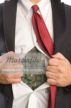 Businessman Opening Shirt to Reveal a Computer Motherboard Stock Photo - Premium Royalty-Free, Image code: 600-02757051