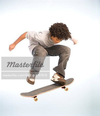 Skateboarder Doing an Ollie Stock Photo - Premium Royalty-Free, Image code: 600-02757072