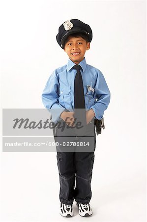 Boy Dressed as Police Officer Stock Photo - Premium Royalty-Free, Image code: 600-02786814