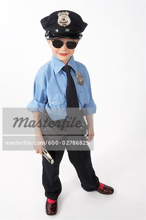 Girl Dressed as Police Officer Stock Photo - Premium Royalty-Free, Image code: 600-02786825