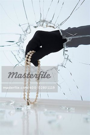Hand Stealing Pearl Necklace Stock Photo - Premium Royalty-Free, Image code: 600-02801119