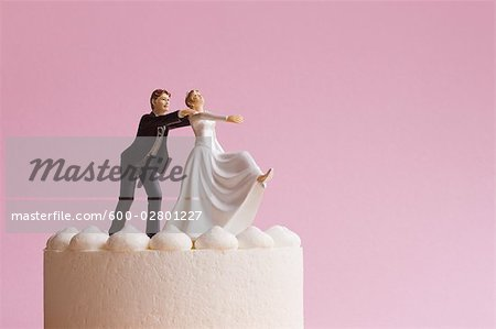 Wedding Cake Figurines, Groom Grabbing Runaway Bride Stock Photo - Premium Royalty-Free, Image code: 600-02801227