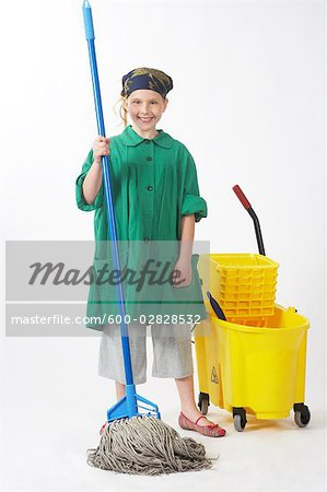 Girl Dressed Up as Janitor Stock Photo - Premium Royalty-Free, Image code: 600-02828532