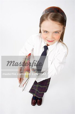 Girl Wearing School Uniform Stock Photo - Premium Royalty-Free, Image code: 600-02828542