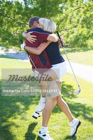 Couple Making Out on Golf Course Stock Photo - Premium Royalty-Free, Image code: 600-02833097
