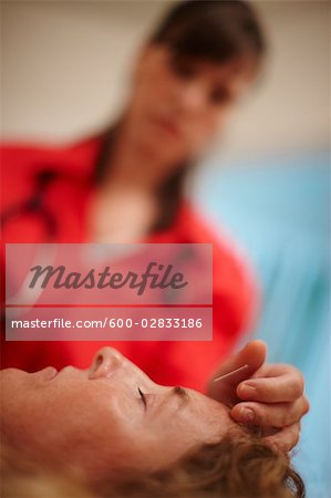 Woman Receiving Acupuncture Stock Photo - Premium Royalty-Free, Image code: 600-02833186