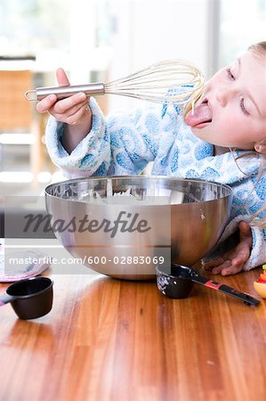 Little Girl Baking, Eating the Batter Stock Photo - Premium Royalty-Free, Image code: 600-02883069