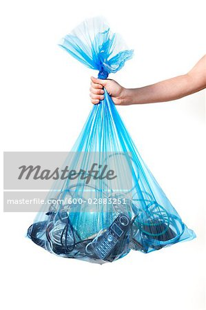 Person Holding Blue Recycling Bag Full of Electronics Stock Photo - Premium Royalty-Free, Image code: 600-02883251