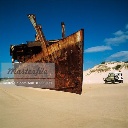 Shipwreck on Beach Stock Photo - Premium Royalty-Free, Image code: 600-02885929