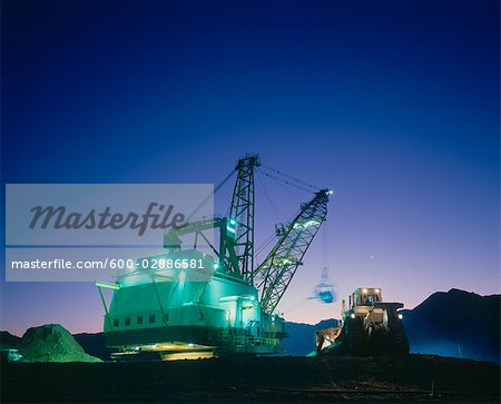 Open Cut Black Coal Mine, Dragline and Bulldozer, Dusk Stock Photo - Premium Royalty-Free, Image code: 600-02886581