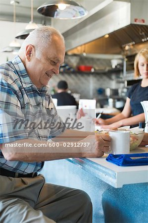 Man in Coffee Shop Stock Photo - Premium Royalty-Free, Image code: 600-02912737