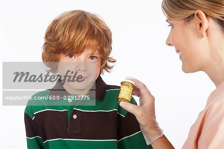 Portrait of Boy and Nurse Stock Photo - Premium Royalty-Free, Image code: 600-02912775