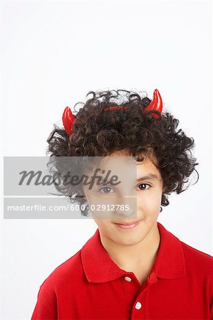 Little Boy Dressed as Devil Stock Photo - Premium Royalty-Free, Image code: 600-02912785