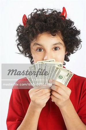 Little Boy Dressed as Devil Holding Cash Stock Photo - Premium Royalty-Free, Image code: 600-02912786