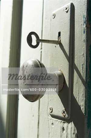 Close-Up of Old Doorknob and Key Stock Photo - Premium Royalty-Free, Image code: 600-03003919