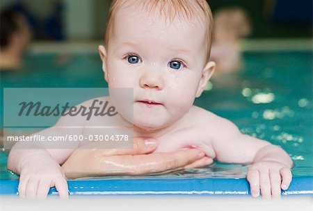 Baby in Swimming Pool Stock Photo - Premium Royalty-Free, Image code: 600-03004378