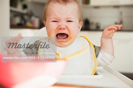 Crying Baby in High Chair Stock Photo - Premium Royalty-Free, Image code: 600-03004392