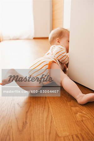 Baby Crawling on Floor Stock Photo - Premium Royalty-Free, Image code: 600-03004407