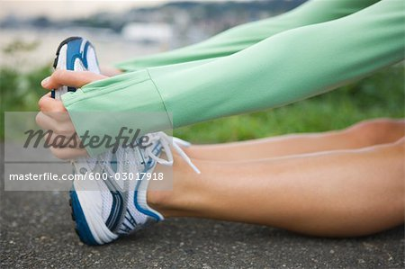 Woman Stretching, Seattle, Washington, USA Stock Photo - Premium Royalty-Free, Image code: 600-03017918