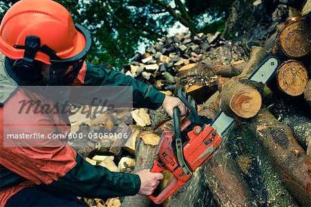 Man Cutting Tree with Chainsaw, Devon, England Stock Photo - Premium Royalty-Free, Image code: 600-03059106