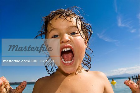 Close-up of Girl Yelling Stock Photo - Premium Royalty-Free, Image code: 600-03152215
