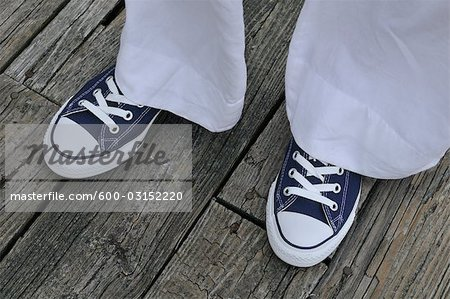 Woman Wearing Sneakers Stock Photo - Premium Royalty-Free, Image code: 600-03152220