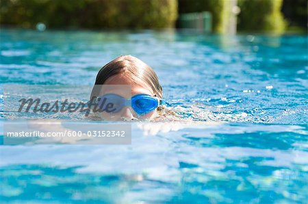 Girl Swimming Stock Photo - Premium Royalty-Free, Image code: 600-03152342