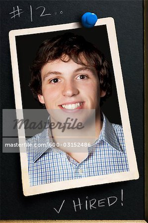 Photograph of Young Man Pinned to Bulletin Board Stock Photo - Premium Royalty-Free, Image code: 600-03152486