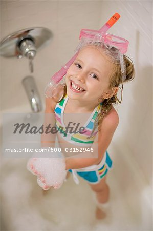Girl with Snorkel in Bathtub Stock Photo - Premium Royalty-Free, Image code: 600-03152946