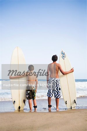 Boys Holding Surfboards Stock Photo - Premium Royalty-Free, Image code: 600-03171577