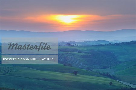 Sunset over Landscape, Montecontieri, Asciano, Tuscany, Italy Stock Photo - Premium Royalty-Free, Image code: 600-03210239
