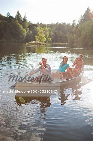 Teenagers Canoeing on Lake Near Portland, Oregon, USA Stock Photo - Premium Royalty-Free, Image code: 600-03210547
