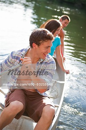 Teenagers Canoeing on Lake Near Portland, Oregon, USA Stock Photo - Premium Royalty-Free, Image code: 600-03210548