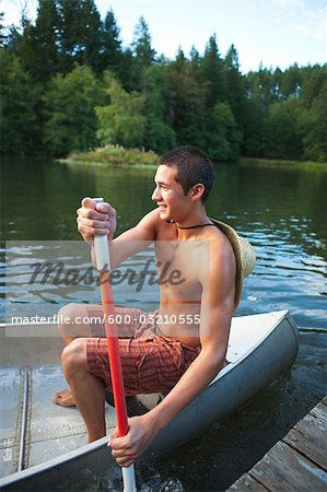 Teenage Boy Canoeing, Near Portland, Oregon, USA Stock Photo - Premium Royalty-Free, Image code: 600-03210555