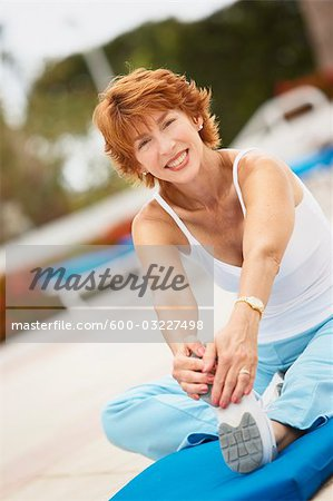 Woman Stretching Stock Photo - Premium Royalty-Free, Image code: 600-03227498