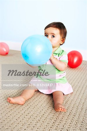 Baby Girl with Balloon Stock Photo - Premium Royalty-Free, Image code: 600-03265817