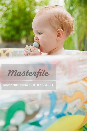 Baby Girl in Inflatable Pool Stock Photo - Premium Royalty-Free, Image code: 600-03284221