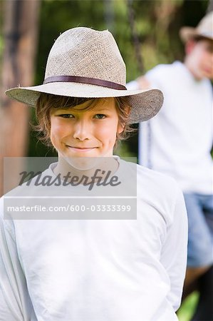 Portrait of Boy Wearing Hat, Salzburg, Salzburger Land, Austria Stock Photo - Premium Royalty-Free, Image code: 600-03333399