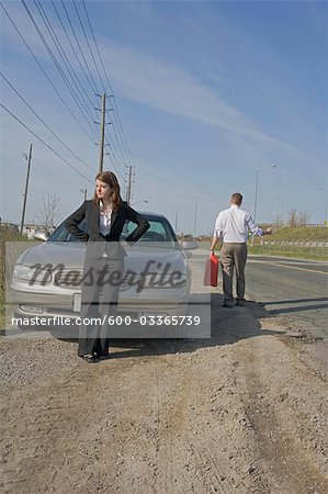 Man With Car Trouble, Man Hitchhiking With Jerry Can Stock Photo - Premium Royalty-Free, Image code: 600-03365739