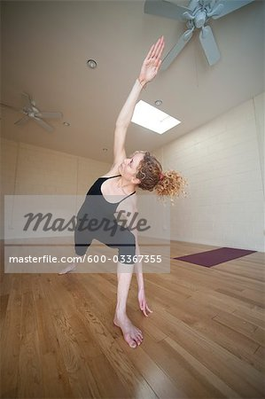 Woman in Yoga Pose Stock Photo - Premium Royalty-Free, Image code: 600-03367355