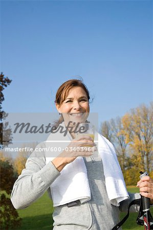 Woman Drinking Glass of Juice Outdoors Stock Photo - Premium Royalty-Free, Image code: 600-03403968