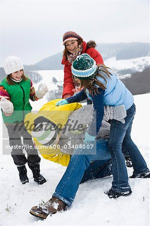 Family Playing Outdoors in Snow Stock Photo - Premium Royalty-Free, Image code: 600-03404007